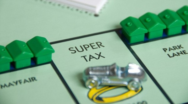Tax on a Monopoly board game with houses